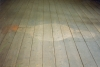 250cm x 100cm, Wooden floor, scoured and gouged out.